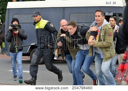 ENSCHEDE THE NETHERLANDS - SEPT 17 2017: A man is being arrested during an anti-islam demonstration of Pegida. His goal was to disturb the protest.