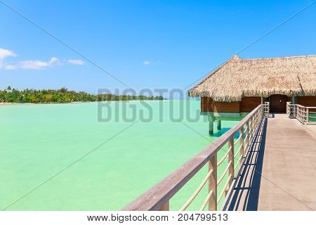 Traditional over water villa on a tropical lagoon of Bora Bora Island Tahiti French Polynesia