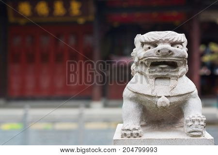 Lion stone statue in a chinese buddhist temple, Chengdu, China