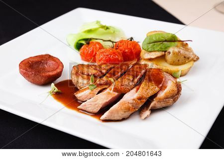 Roasted duck with pear, marinated in red wine and mascarpone rose