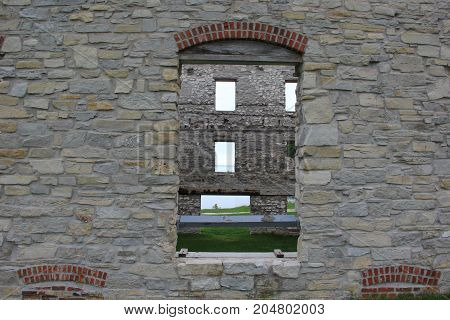 Looking through a window of a ruined building in Fayette Historic State Park, Upper Peninsula of Michigan