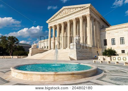 The United States Supreme Court at sunset in Washington DC, USA.