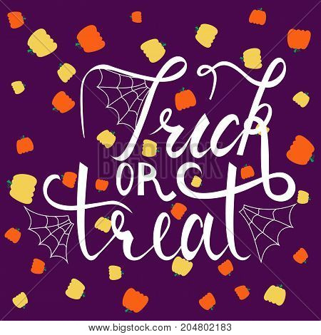 Trick or treat modern brush inscription. Illustrated phrase for Halloween on background with pumpkins
