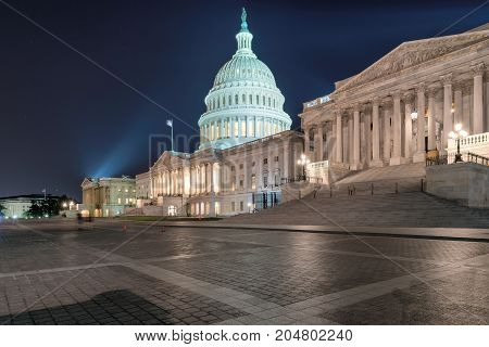 The US Capitol building at night in Washington DC, USA
