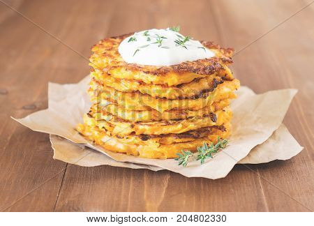 Butternut squash fritters with yogurt and fresh thyme. Paleo diet fritters