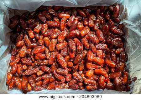 Dried dates in the box. Background.  Exotic fruit.