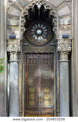 Beautiful old wooden door on the wall of the house
