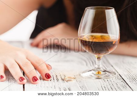 Drunk Woman Alone In Wasted And Depressed,  Alcohol Abuse And Alcoholic Housewife Concept