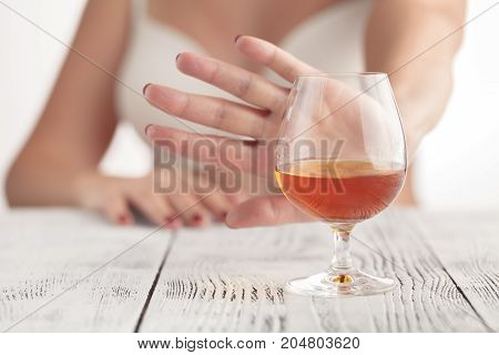 woman hand refused a glass of wiskey
