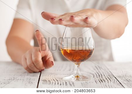 beautiful woman do gesturing don't drink more