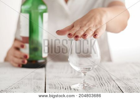 Woman refuses to drink more alcohol from glass