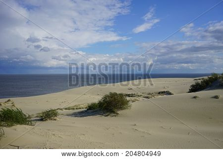 Deserted seascape on the Baltic sea and sand dunes
