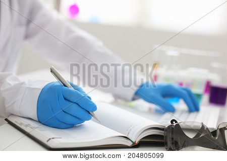 Employee Of The Chemical Laboratory Teacher Chemist Holds A Silvery Pen