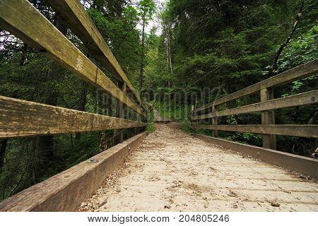 Wooden bridge in the Tyrolean Alps in summer