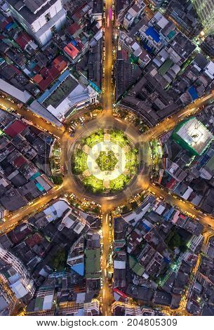 Aerial view Road roundabout Expressway with car lots in the city in Thailand. beautiful Street downtown cityscape Top view. Background road.