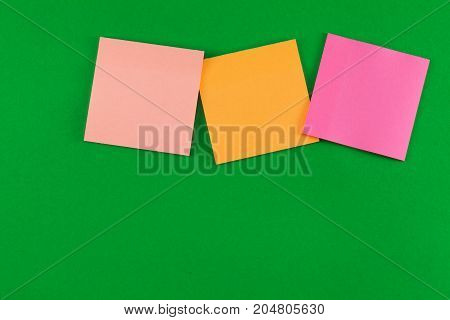 Paper sheets with notes on the wall