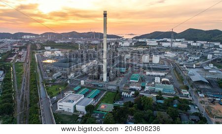Aerial view Oil refinery.Industrial view at oil refinery plant form industry zone with sunrise and cloudy sky.Oil refinery and Petrochemical plant at dusk Thailand.