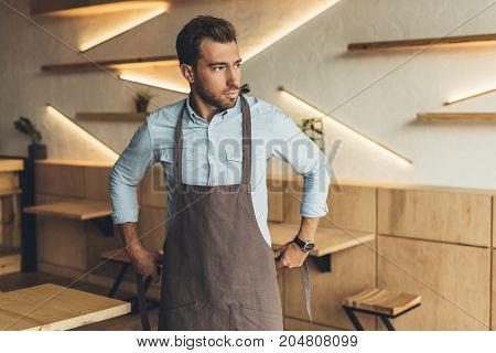 Worker Wearing Apron