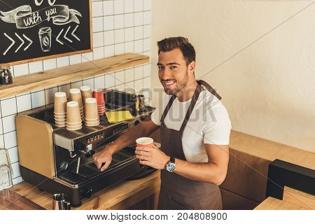 Smiling Barista With Coffee To Go