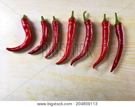 Ring of fire chillies laid out on a chopping board