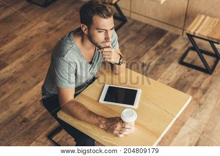 Pensive Man In Cafe