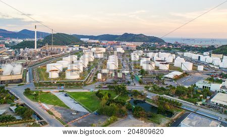 Aerial view Oil refinery.Industrial view at oil refinery plant form industry zone with sunrise and cloudy sky.Oil refinery and Petrochemical plant at duskThailand. Oil refinery background sunset.