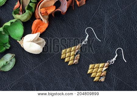 Woven Earrings Of Bronze Color Beads Close Up
