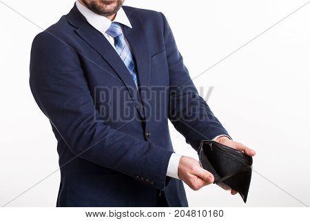 businessman in blue suit shows an empty black wallet
