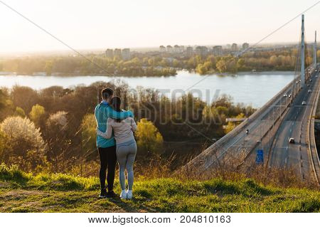 Happy young sporty couple sharing romantic moments in nature