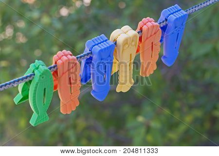 the Colorful clothes pegs on a rope