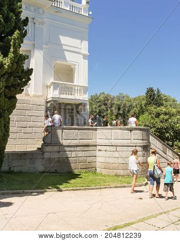Yalta, Crimea - 11 July, Visitors at the palace, 11 July, 2017. Architecture of the Levada Palace in Yalta.
