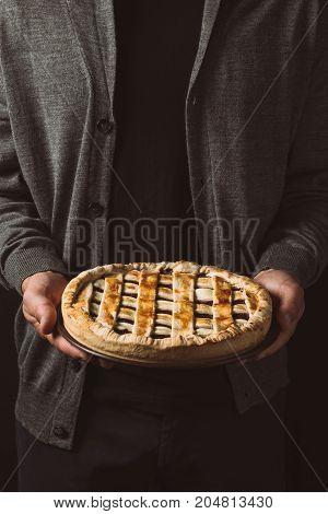 Man Holding Homemade Pie