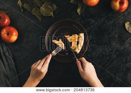 Woman Cutting Apple Pie