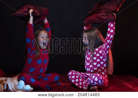 Pjs Party For Children: Girls Shouting And Fighting With Pillows