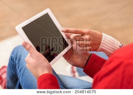 close-up partial view of couple using digital tablet with blank screen