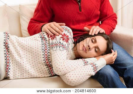 Girl Sleeping On Knees Of Boyfriend