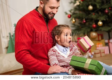 Father And Daughter With Christmas Gifts