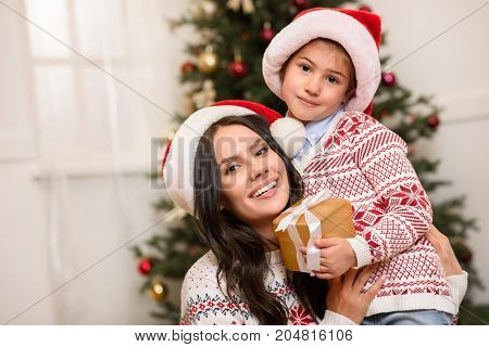 Mother And Daughter With Christmas Gift