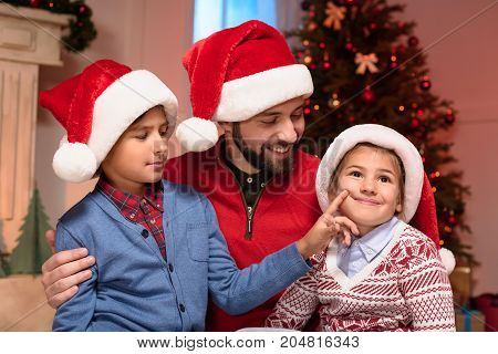 Father And Kids In Santa Hats