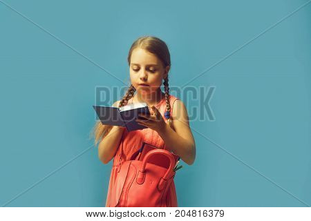 Kid With Concentrated Face Expression On Blue Background