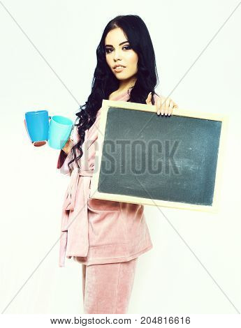 Girl In Pink Velour Home Suit With Cup And Board