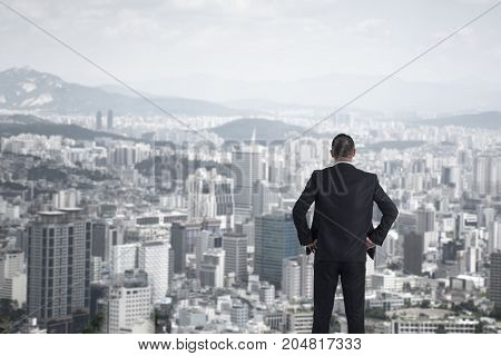man in suit looking to cityscape, Business concept