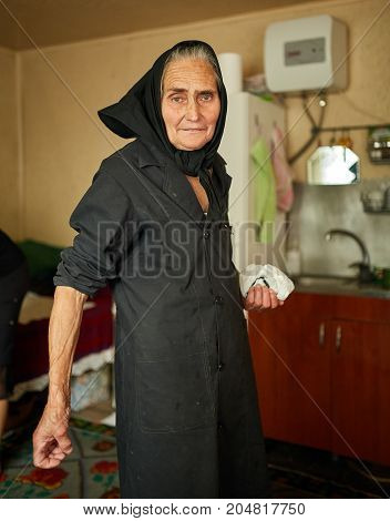 Closeup of a happy elderly rural woman in her home