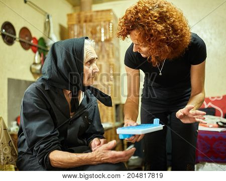 Daughter Helping Her Mother With The Medication