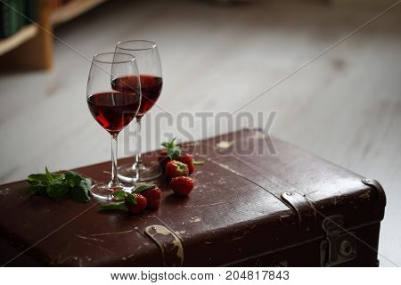 Wineglasses With Red Wine Decorated With Strawberry And Mint