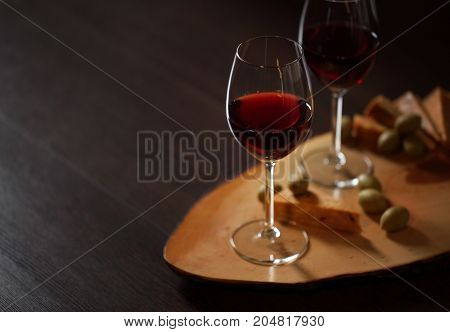 Wineglasses With Red Wine On Wood With Cheese And Green Olives - With Space For Text