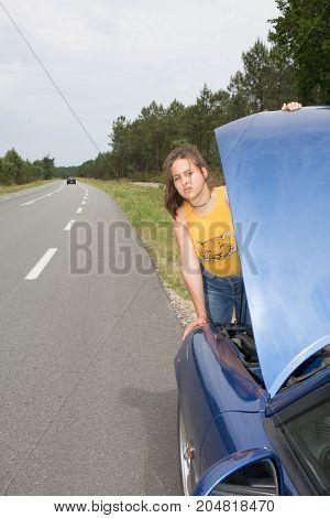 Attractive Brunette In Front Of Her Car Broken Down Car