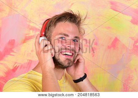 American Handsome Bearded Guy With Headphones. Musical Lifestyle.