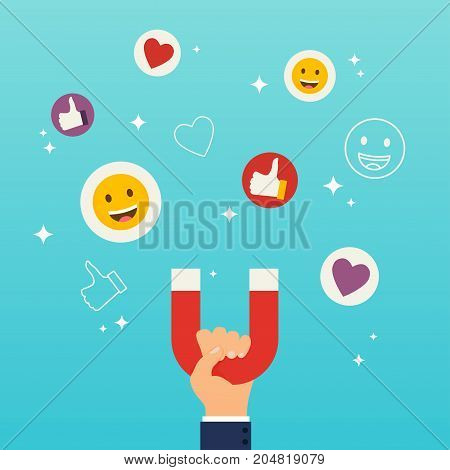Social media marketing concept. Hand holding magnet attracting likes hearts and reaction smileys.