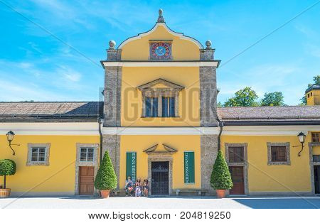 Salzburg Austria - August 3 2016: Visitors in the side entrance of he Hellbrun palace